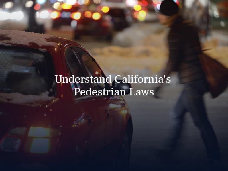 """a person crossing the street in front of a red sedan. Text: """"Understand California's Pedestrian Laws"""""""